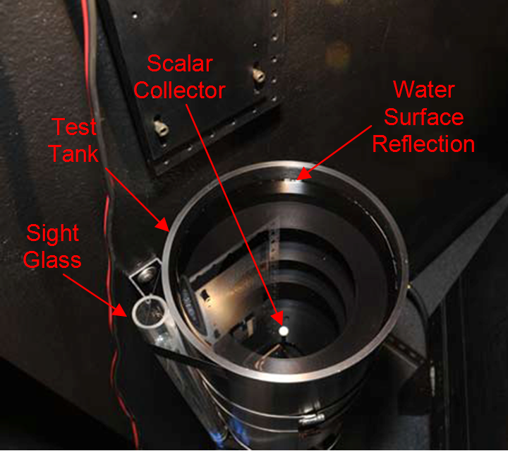 Figure 1. The 1.3 cm AMOUR irradiance collector is shown immersed in water in a tank to determine the immersion coefficient. The small cylinder at the left is a sight glass to determine the water level. A light-limiting aperture at the top of the tank has been removed for clarity.