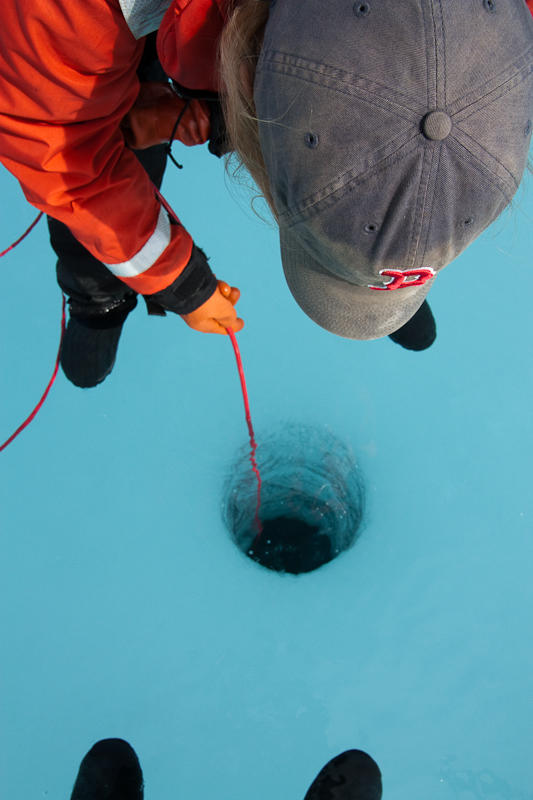 Figure 3. Dr. Karen Frey and her students deploy ICE-Pro through a hole bored through the ice on the NASA-sponsored research cruise.