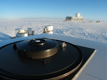 [b]Figure 1[/b]: Installation of the UV monitoring system at Summit Greenland. The irradiance collector of a BSI SUV-150B spectroradiometer is shown in the foreground. Instruments in the background include a GUV-511 multi-filter instrument from BSI and a PSP pyranometer from Eppley Laboratory.